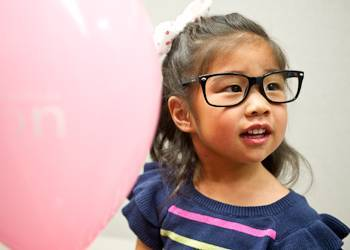 Child with glasses at Las Colinas Vision Center